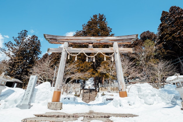 Japan torii gate entrance shrine in snow scene