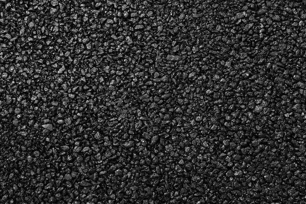 Japanese asphalt pavement with a beautiful black and gray texture and lit with a soft light.