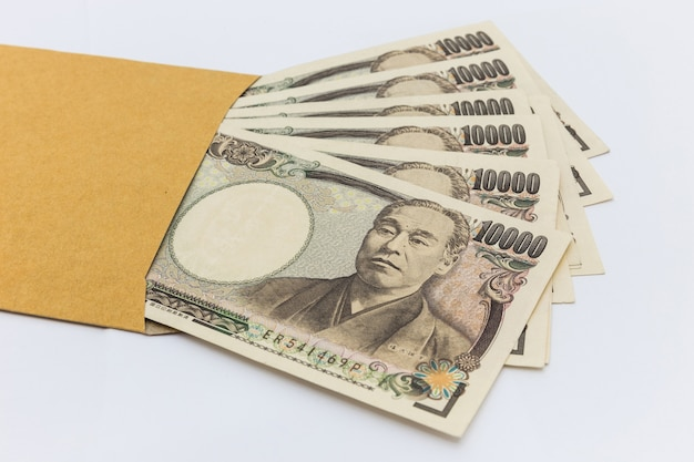 Japanese banknote 10,000 yen in brown envelope for give and business success and shopping.