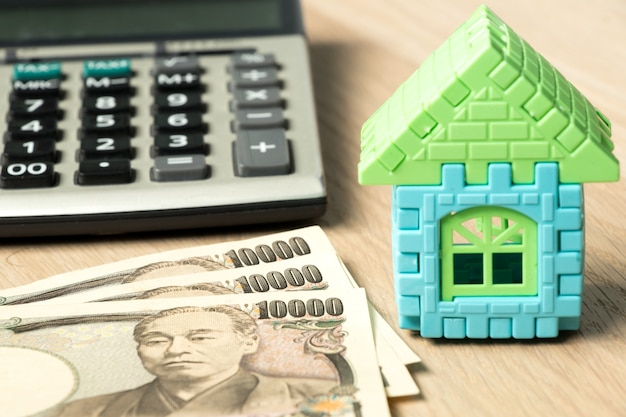 Japanese banknote, toy home puzzle and calculator