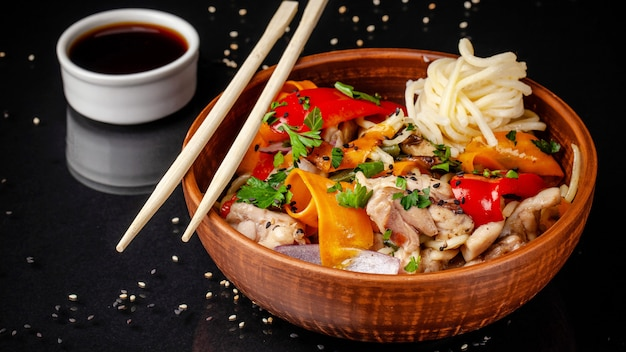 Japanese or chinese udon noodles with chicken and vegetables