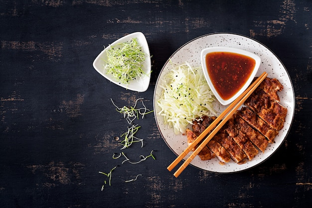 Japanese chop with cabbage and tonkatsu sauce.