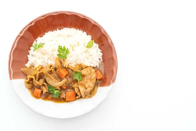 Japanese curry rice with sliced pork, carrot and onions isolated on white
