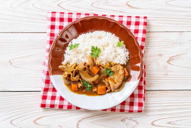 Japanese curry rice with sliced pork, carrot and onions