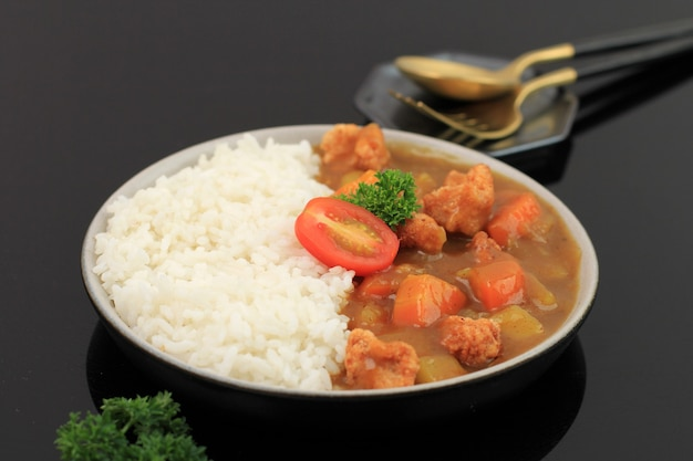 Japanese curry with chicken popcorn, served with white rice. isolated on black background