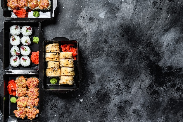 Japanese food concept. catering, various kinds of sushi rolls set.   top view. copy space.