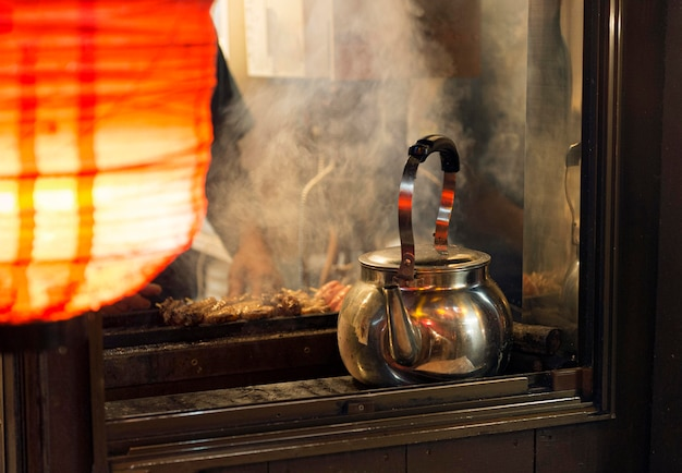 Japanese food court with teapot heating up