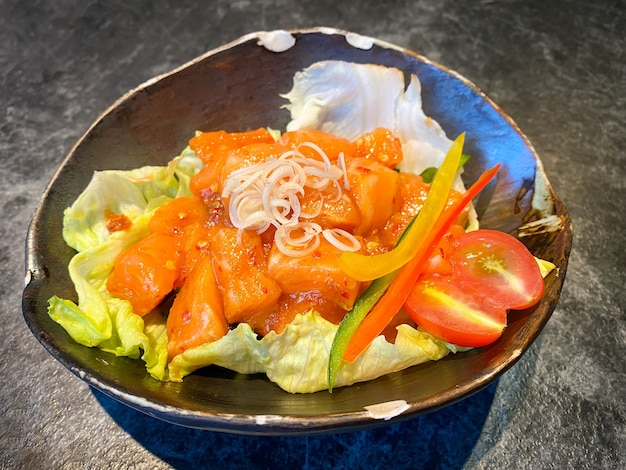 Japanese food, fresh salmon with spicy sauce