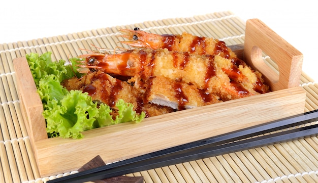 Japanese food - fried tempura shrimps and fried pork.