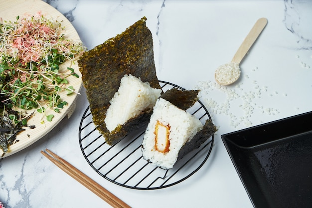 Japanese food made from white rice formed into triangular with pan fried pork. copy space
