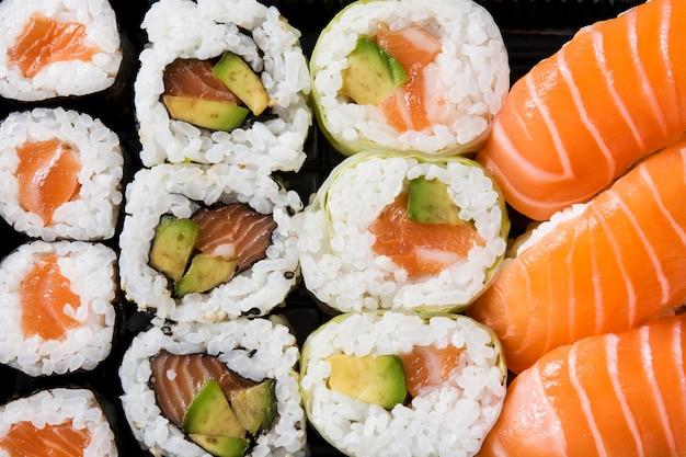 Japanese food: maki and nigiri sushi set on black. close up