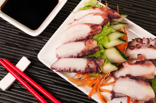 Japanese food octopus sashimi and veggies dish meal, asian fresh food, sea food