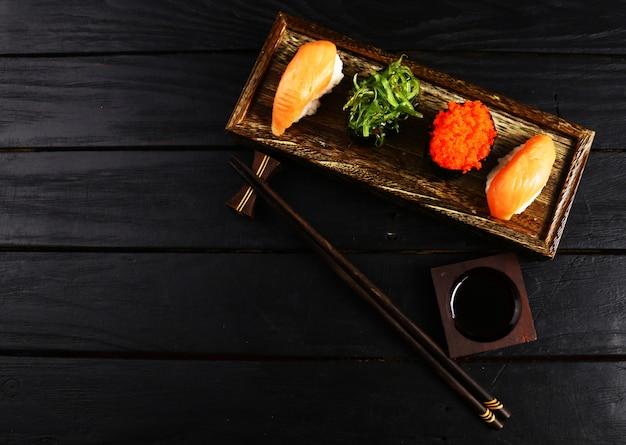 Japanese food restaurant, sushi salmon and seaweed salad