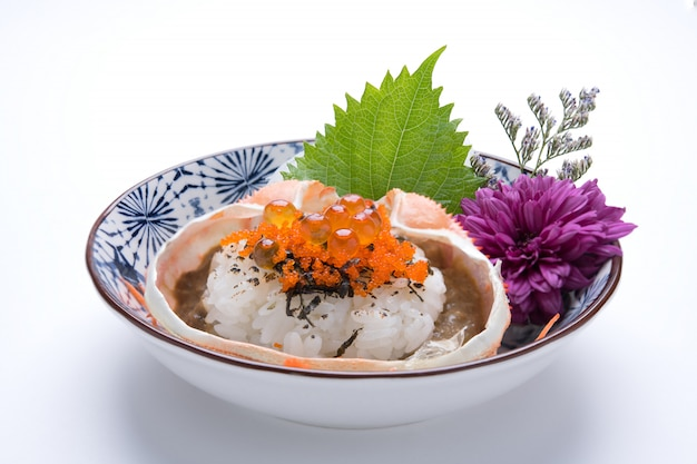 Japanese food rice with kani miso, crab dinner meal isolated on white background