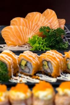 Japanese food sashimi salmon and set different types of sushi with seaweed salad