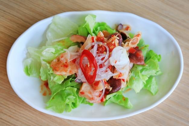 Japanese food, spicy octopus tako salad on wooden table.