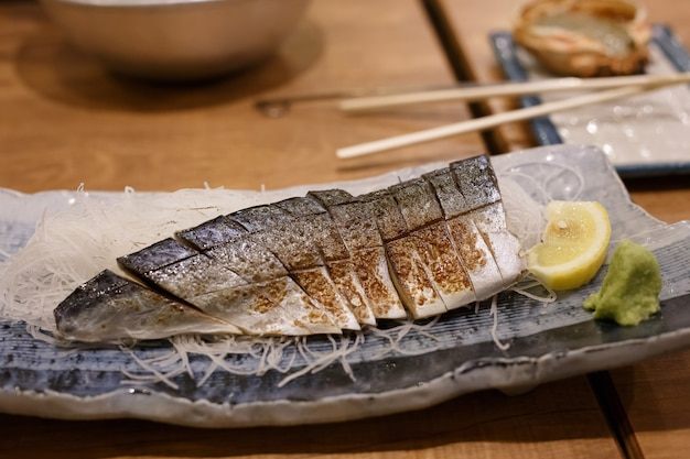 Japanese food style , saba fish grilled. in dish on wood table. traditional menu of japan.