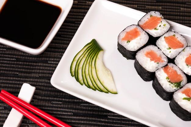 Japanese food sushi, salmon rice and vegetables, asian food with refreshing fish and veggies, organic food, natural sea food