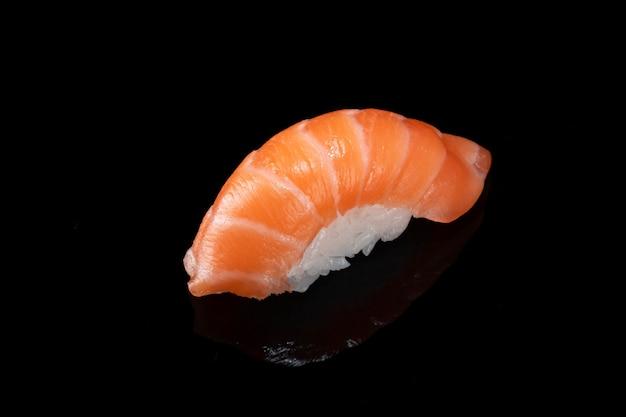Japanese fresh sushi nigiri with salmon isolated on black