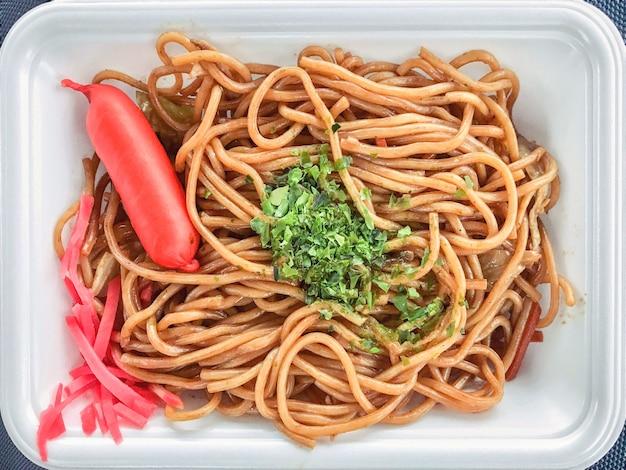 Japanese fried noodle yakisoba on white tray.