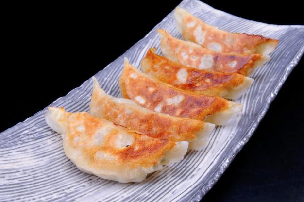 Japanese gyoza set to serve.
