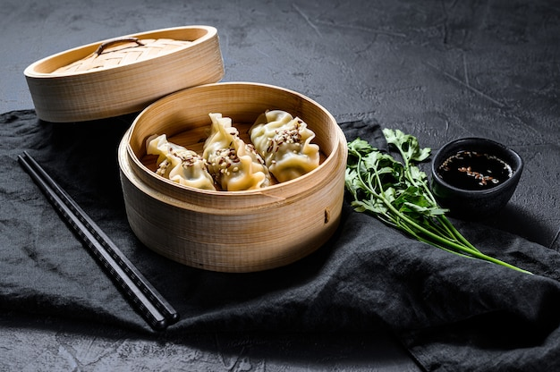 Japanese gyoza in a traditional bamboo steamer