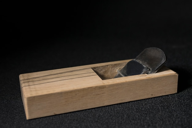 Japanese hand plane on a black background