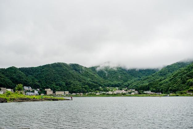 Japanese lake near fuji mount with fisher man
