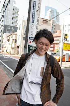 Japanese man walking outdoors