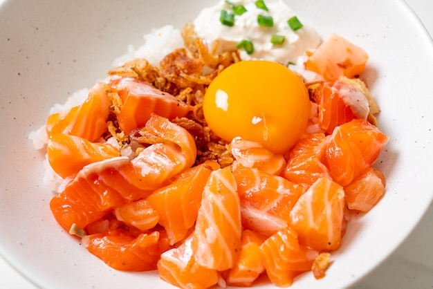 Japanese rice with fresh salmon raw and pickled egg. asian food style
