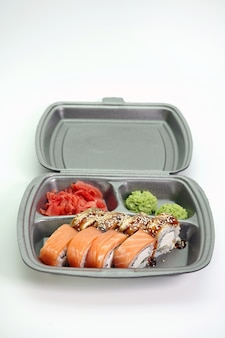 Japanese roll delivery service on an isolated white wall