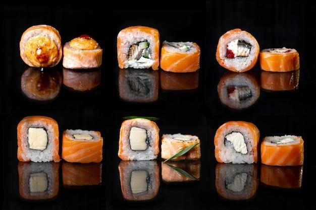 Набор японских роллов. набор роллов и суши на черном фоне
