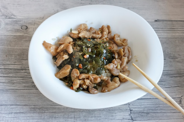 Japanese salad with sea kale, chicken fillet and boiled rice