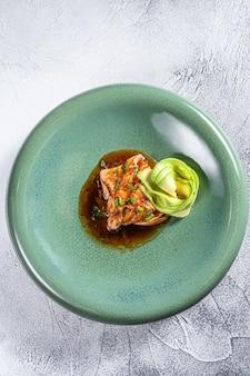 Japanese salmon fish fillet glazed in teriyaki sauce with avocado