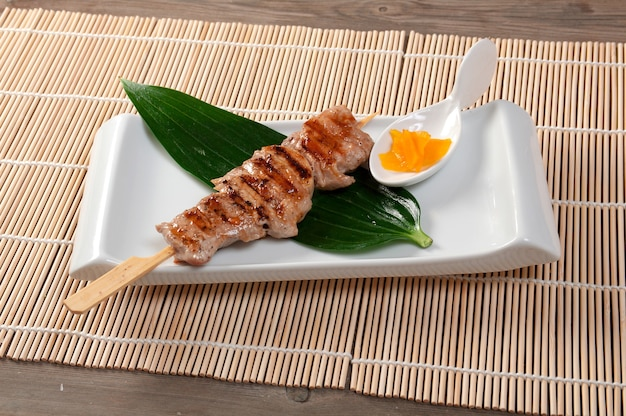 Japanese skewered chicken yakitori closeup