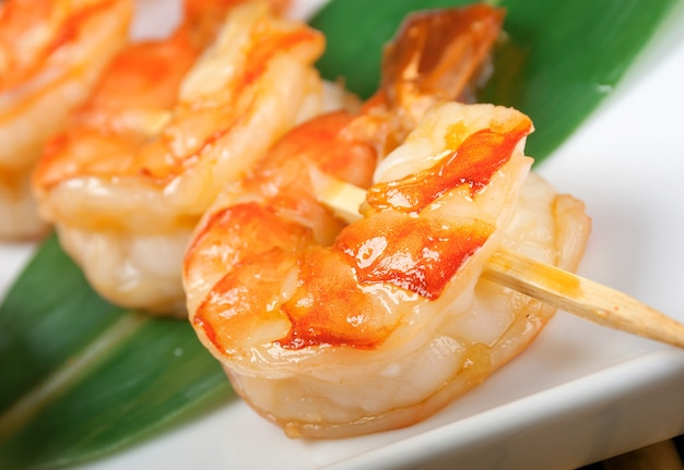 Japanese skewered seafoods royal prawn closeup
