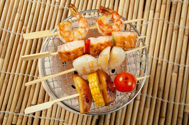 Japanese skewered seafoods vegetables yakitori closeup