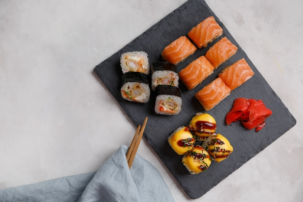 Japanese sushi food. assorted sushi top view. sushi roll on gray surface with copy space
