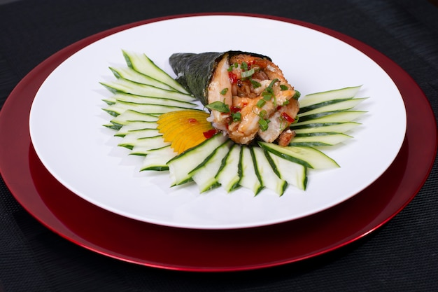 Japanese sushi roll temaki with fresh fish and veggies
