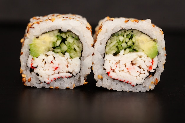 Japanese sushi roll with salmon and cucumber.