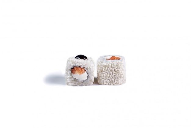 Japanese sushi rolls isolated on white.
