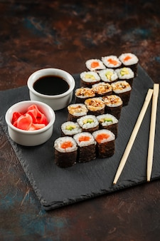 Japanese sushi on a rustic dark background.