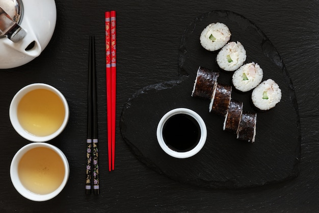 Japanese sushi with soy sauce on gray plate