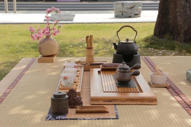 The japanese tea set under sakura tree in zen garden