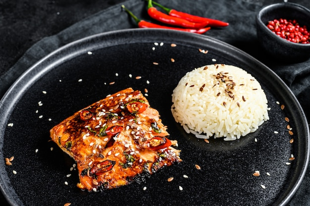 Japanese teriyaki grilled salmon fillet glazed in delicious sauce with a side dish of rice. top view