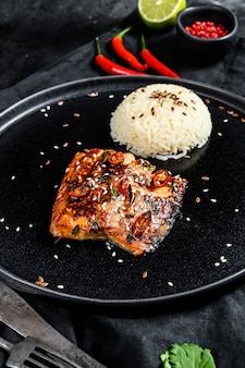 Japanese teriyaki grilled sea trout fillet  with a side dish of rice. top view