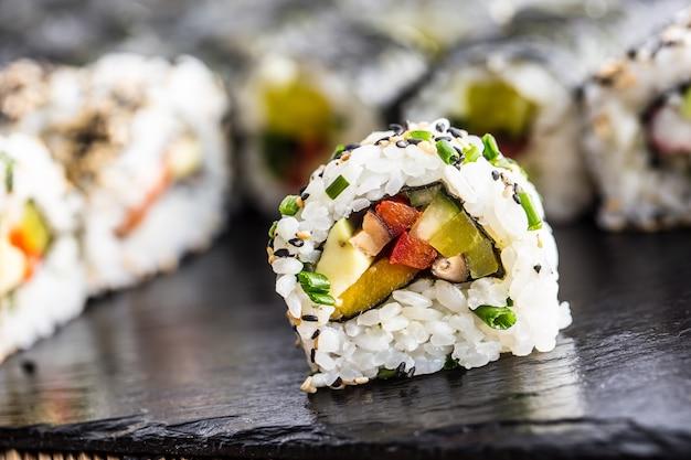 Japanese traditional food sushi uramaki on slate board.