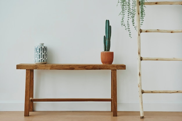 Japanese vase and cactus on a wooden bench