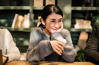 Japanese woman having a coffee