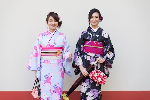 Japanese women with kimono walking in tokyo